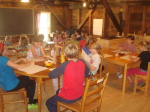 Students at the Mill School working in their classroom during a lesson.