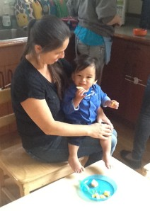 Infant/Toddler Head Teacher, Seferina Rivera at snack time